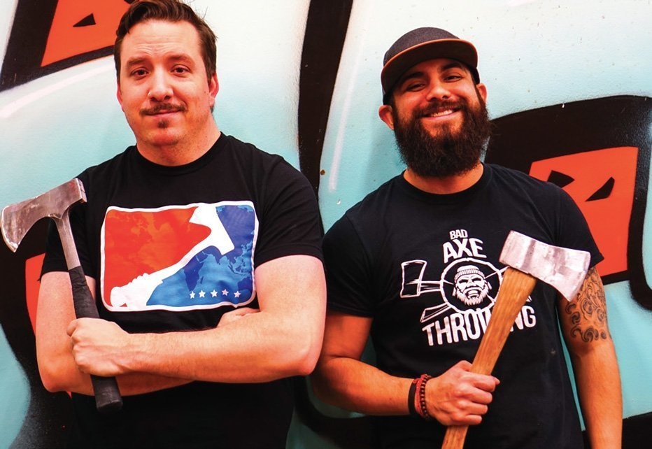 Ben Edgington (left) and Eric Enriquez (right) pozing with their axes.