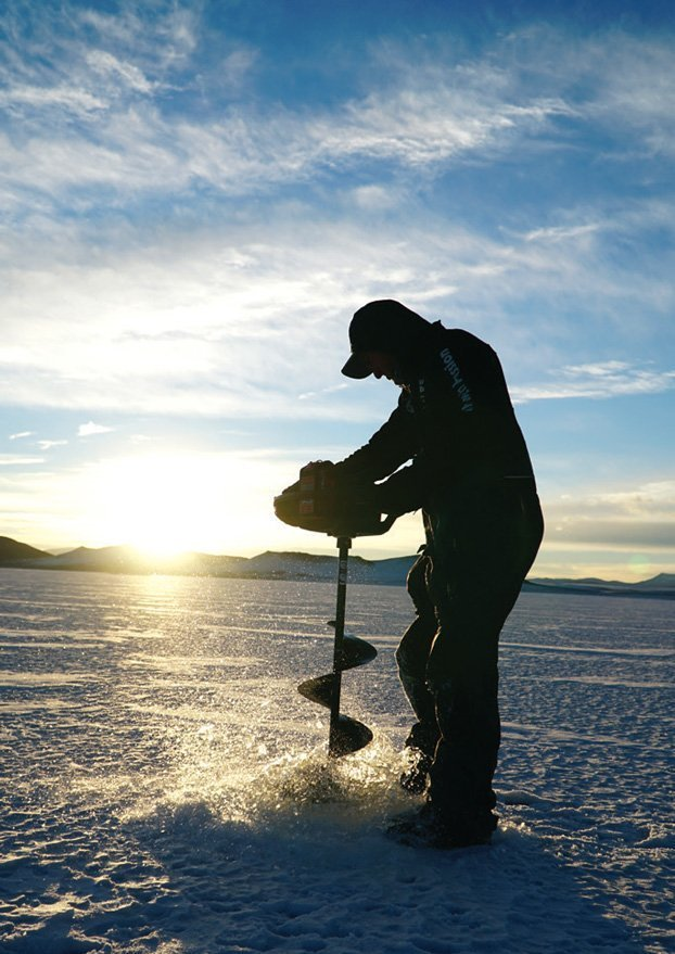 Robby Richardson drilling into the ice of Antero Reservoir.