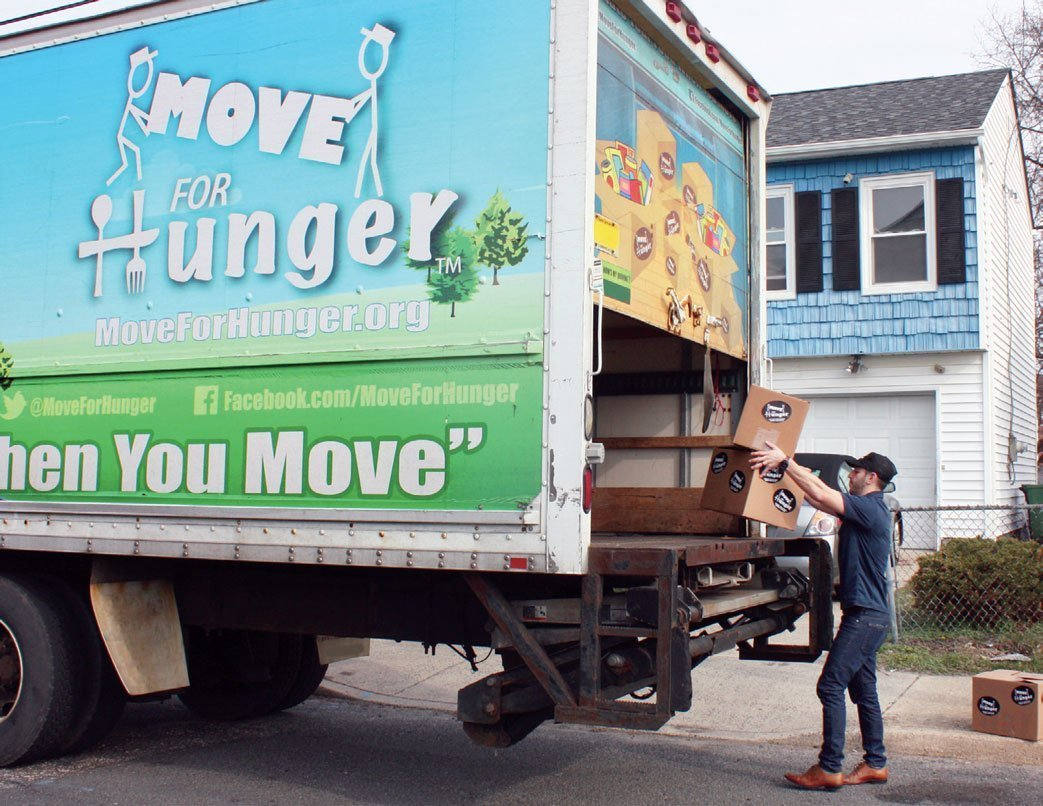 Movers fill a Move For Hunger truck.