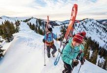 Skiers walking uphill