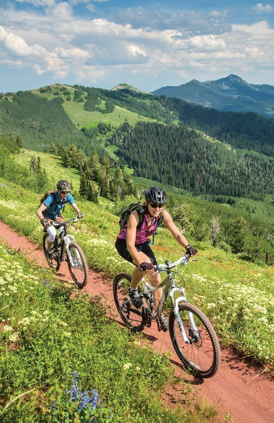 people-biking-on-trail
