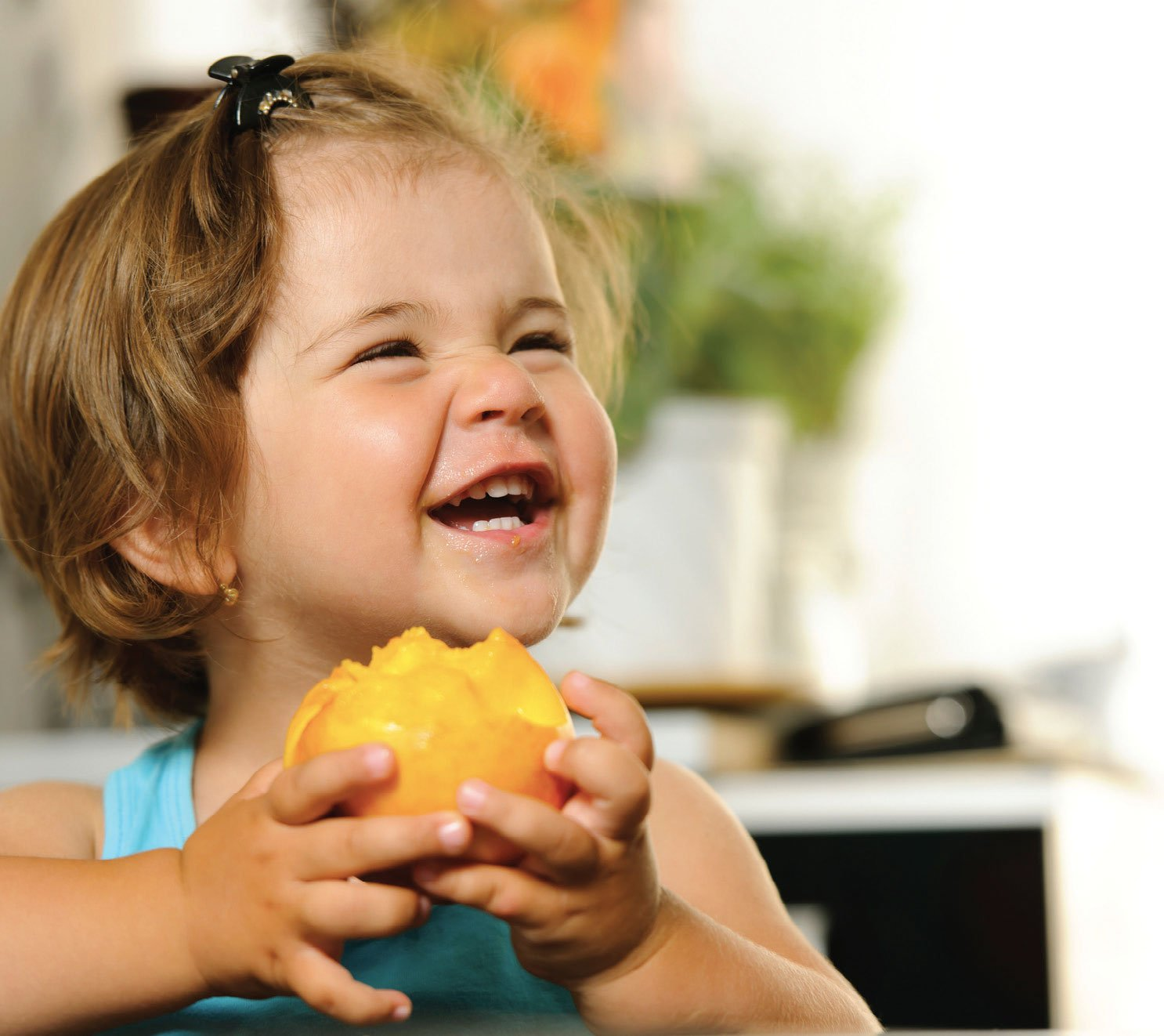 A child eating a fruit.