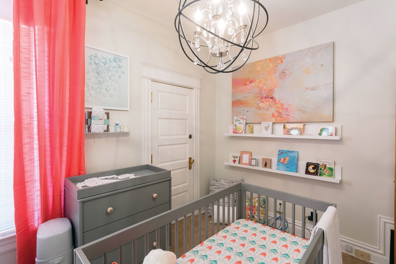 Nursery window, crib, and ceiling light.