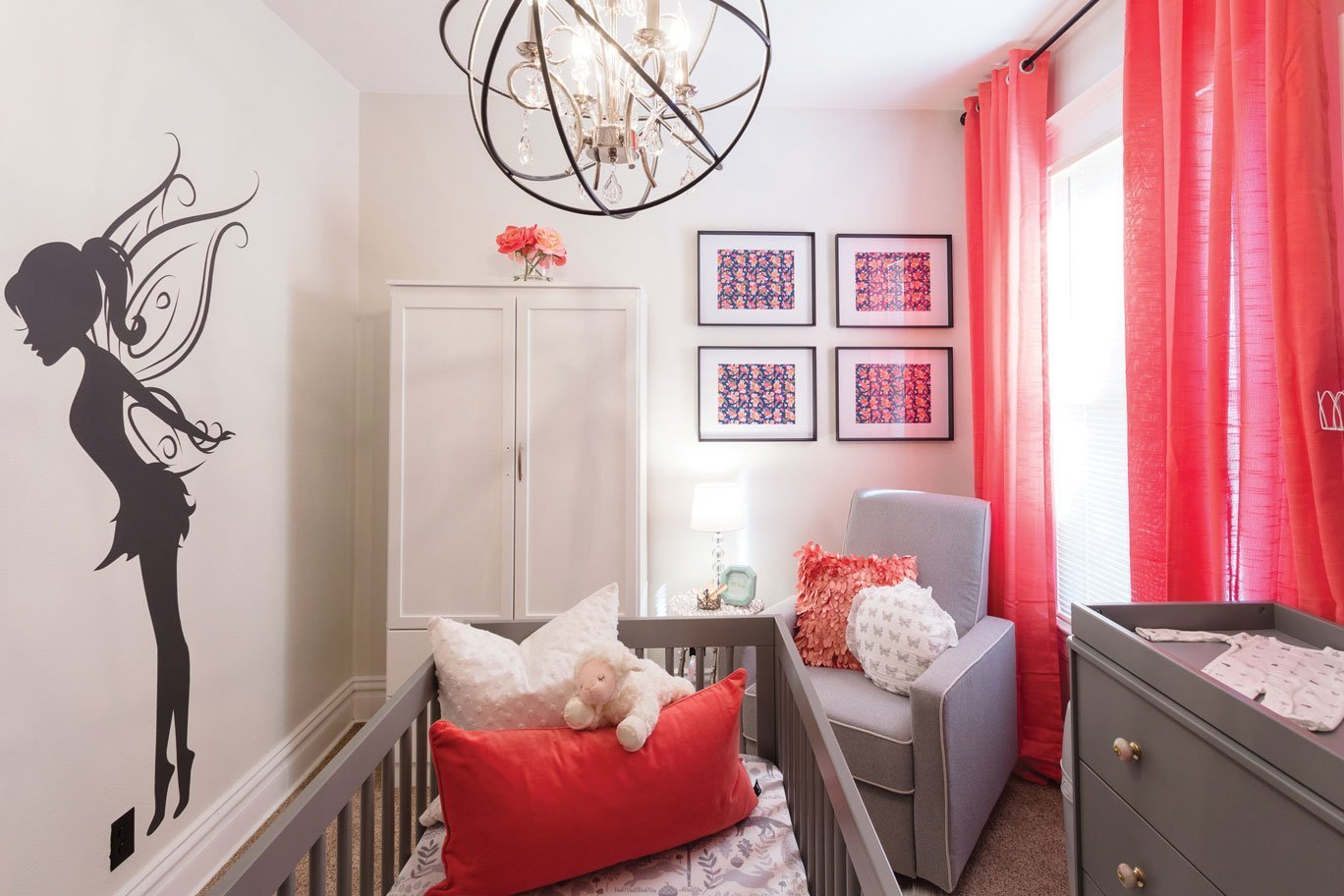 Stylish nursery with wall art