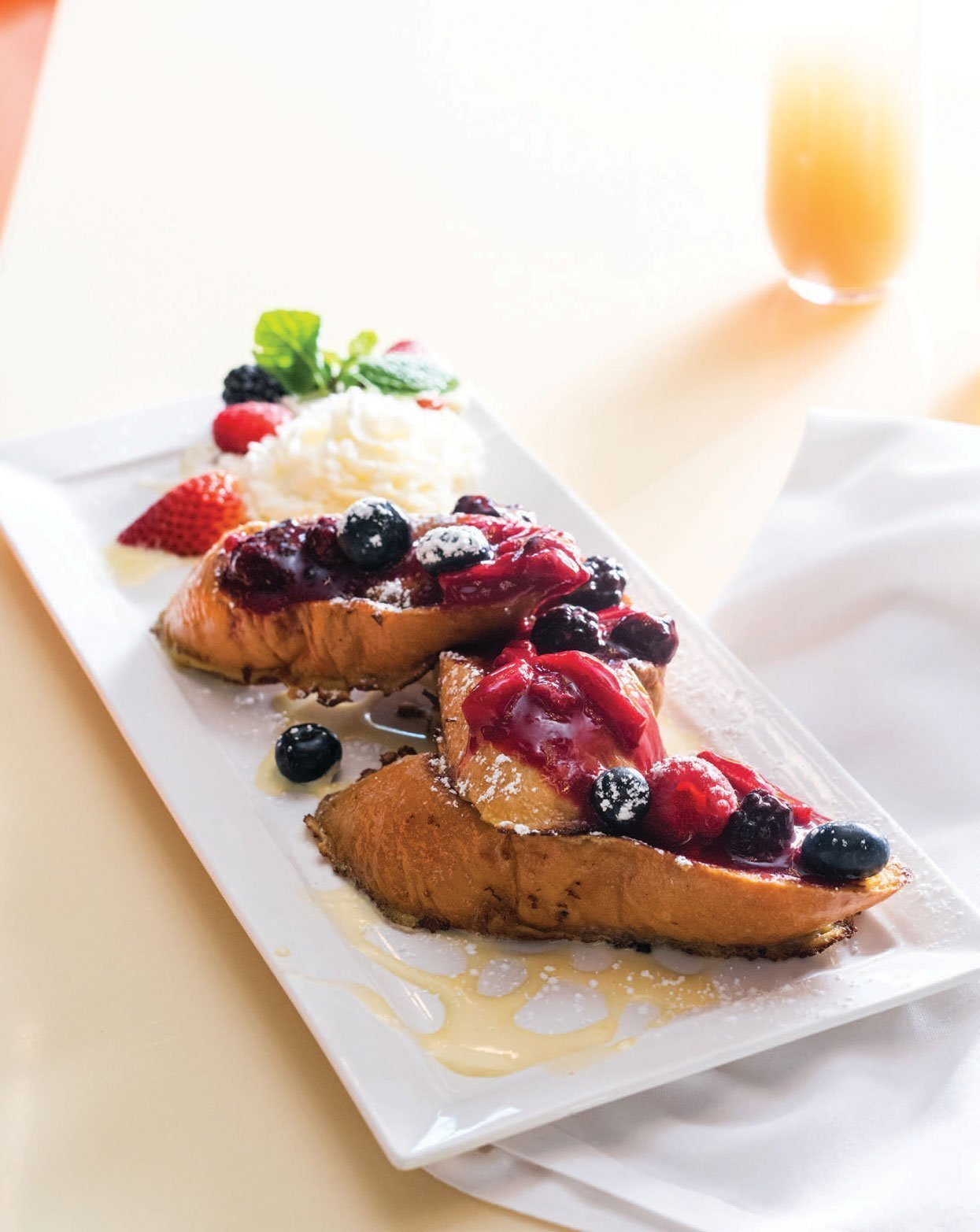 French toast with fruit on a plate.