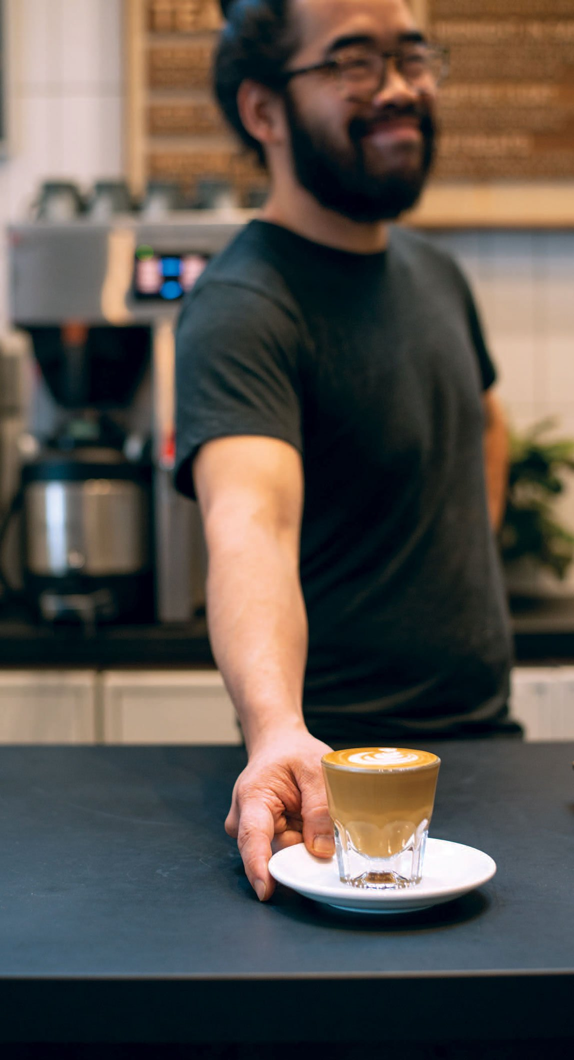 Duc Huynh serves up his famous craft coffee.