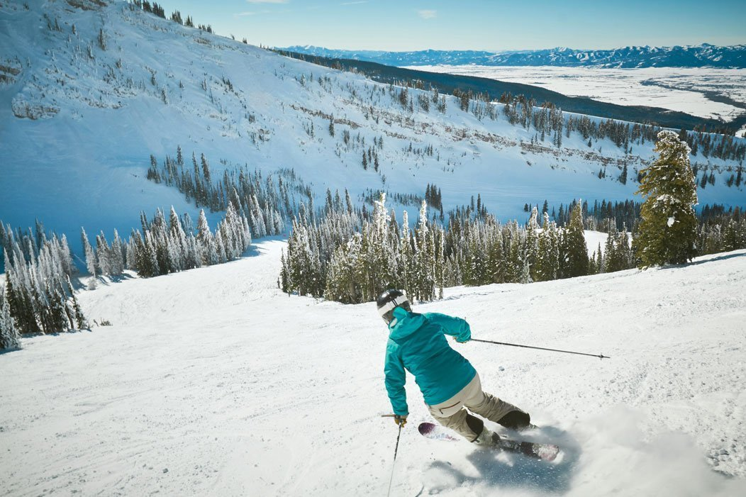 A skier skiing on a ski mountain.