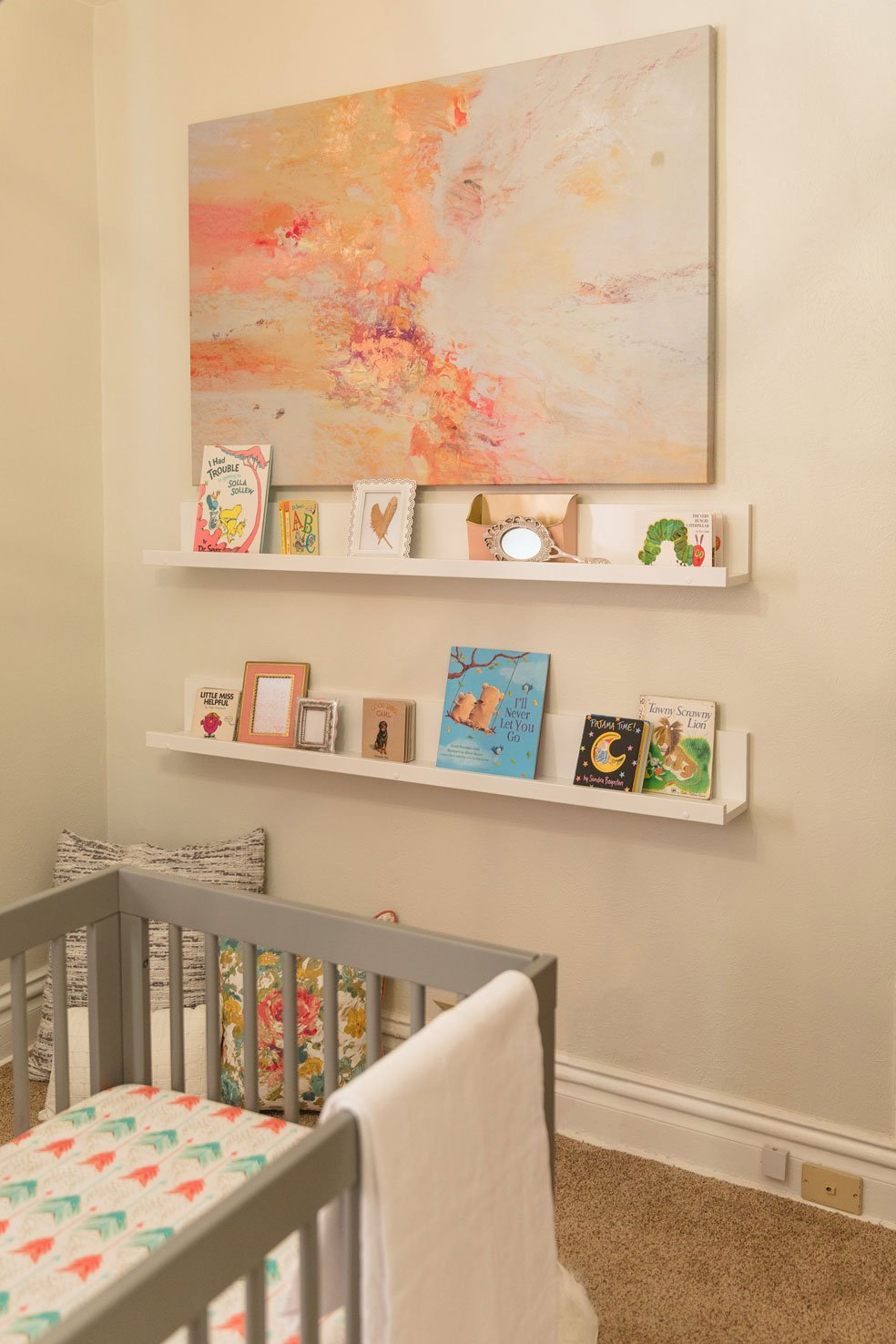 Wall art and shelves of the nursery.